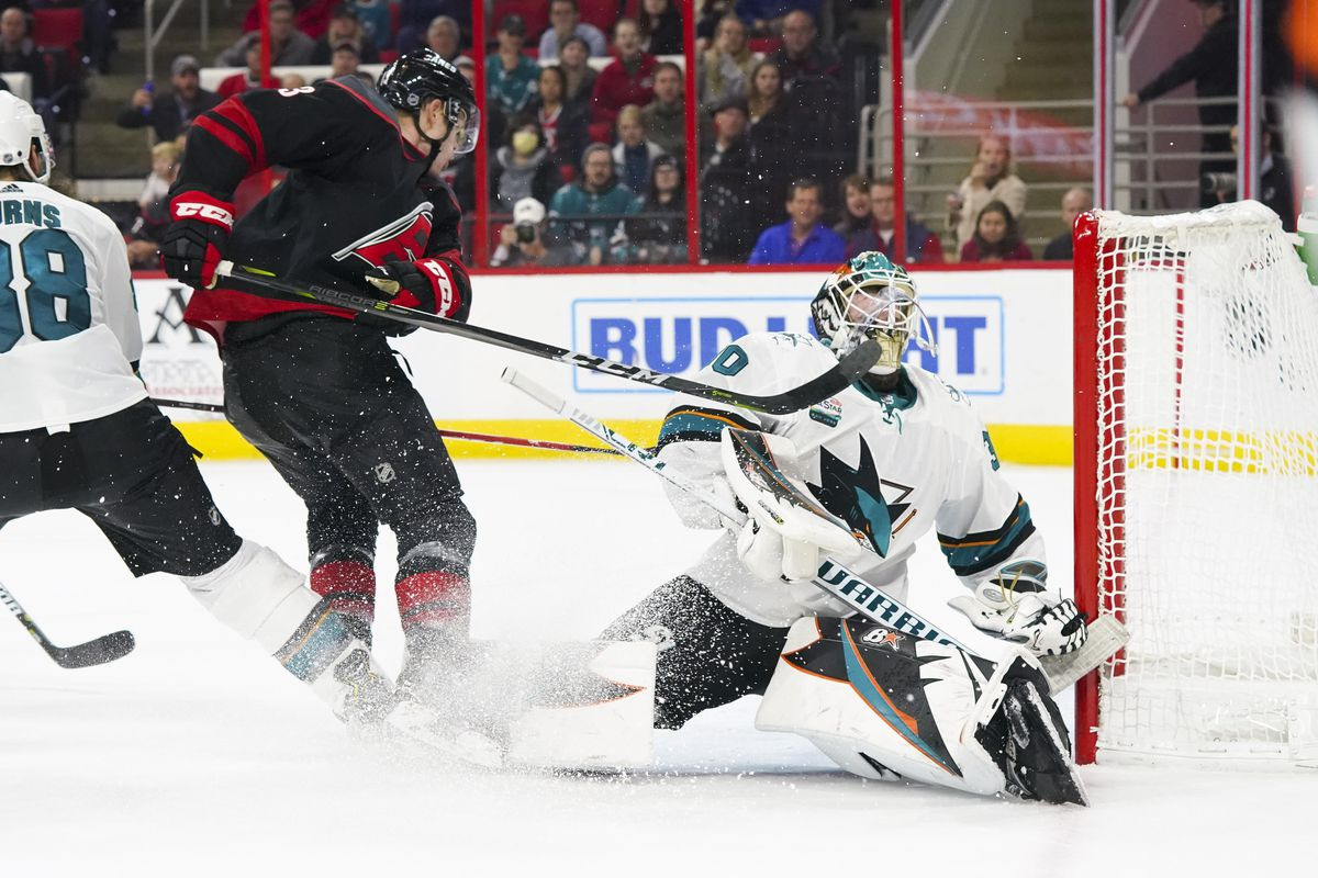 Oct 26, 2018; Raleigh, NC, USA; San Jose Sharks goaltender Aaron Dell (30) catches a stick from Carolina Hurricanes left wing Warren Foegele (13) during the overtime at PNC Arena. The Carolina Hurricanes defeated the San Jose Sharks 4-3 in the shoot out.