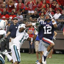 Mississippi wide receiver Donte Moncrief  (12) reaches for a touchdown pass in front of Tulane cornerback Jordan Batiste (14)  the first half of an NCAA college football game in New Orleans, Saturday, Sept. 22, 2012.