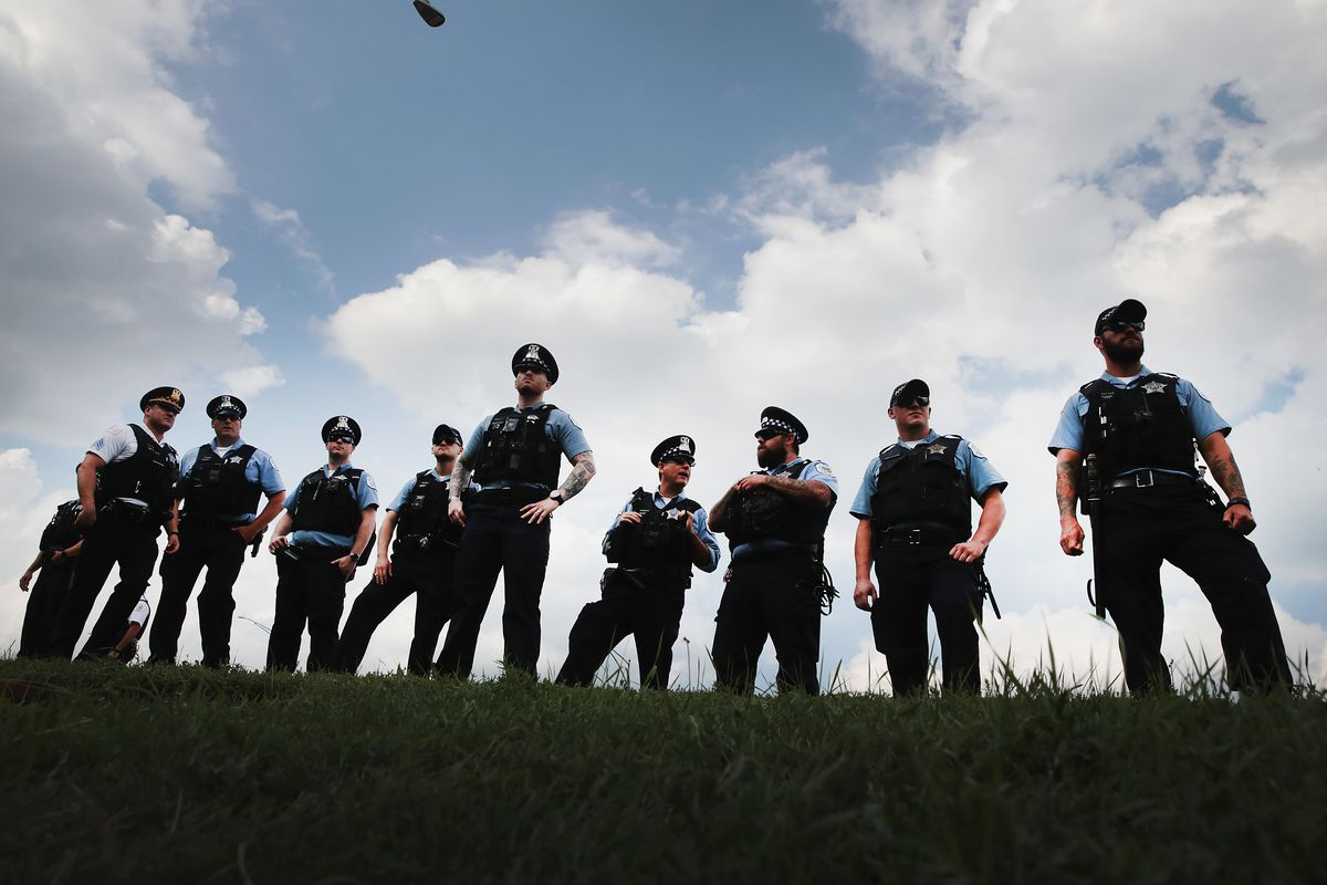 Police officers stand alongside Lake Shore Drive in August as protesters decry violence and lack of investment in African-American neighborhoods and schools