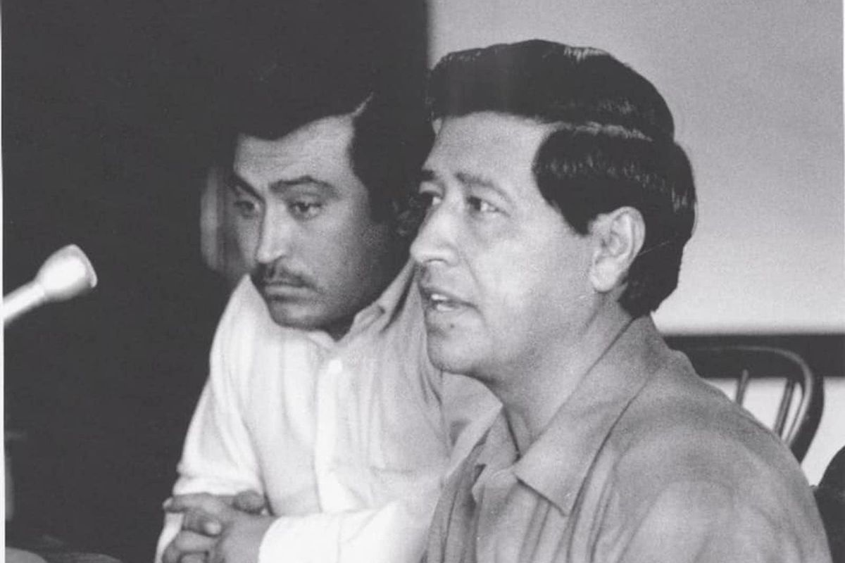 Marcos Muñoz (left) worked with Cesar Chavez, a founder of the United Farm Workers, for better conditions for laborers.