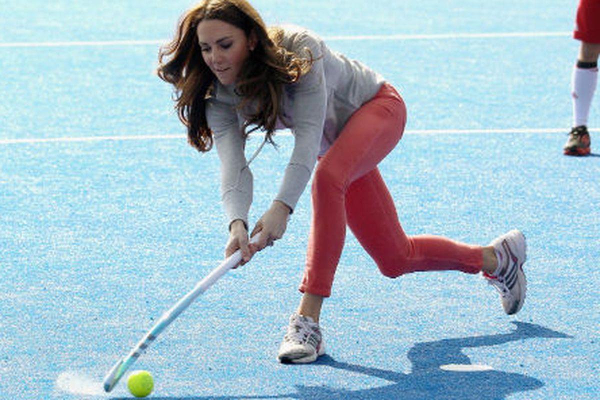 Kate Middleton plays field hockey. Photo via Getty.