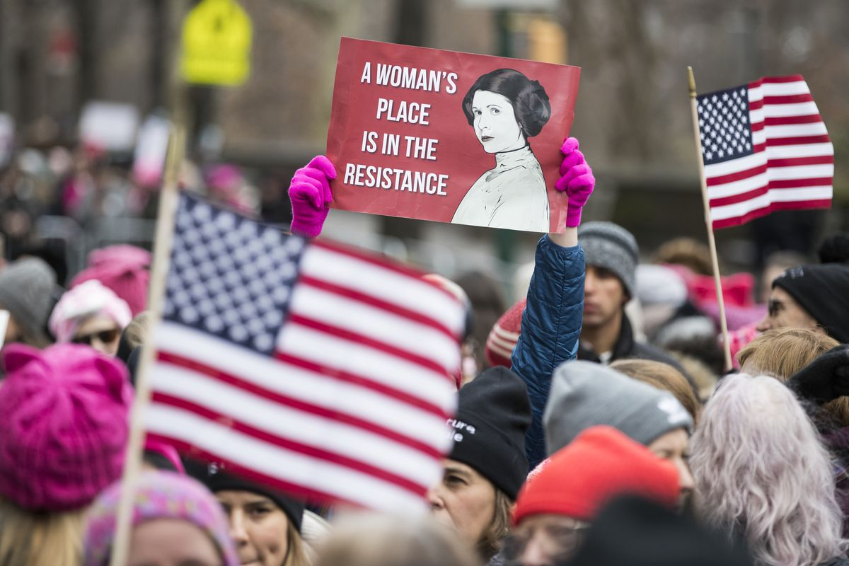 A protest sign of Star Wars' Princess Leia among US flags during the Women's March on January 19, 2019, in New York.