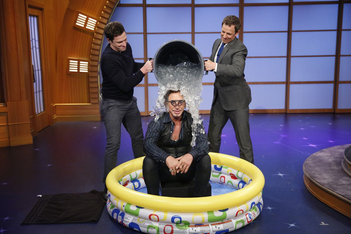 Syd Butler and host Seth Meyer dump a bucket of ice on actor Mickey Rourke.