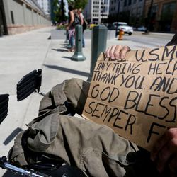 Bill, a U.S. Marine Corps veteran, panhandles outside Temple Square in Salt Lake City on Friday, May 1, 2015. A Utah Policy poll finds 2/3 of Salt Lake City residents think panhandling should be illegal.