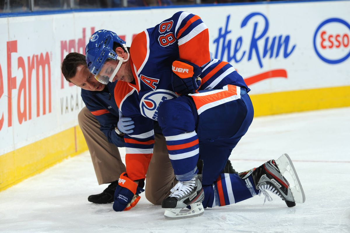 EDMONTON, CANADA - SEPTEMBER 24: Sam Gagner #89 of the Edmonton Oilers is looked at by one of the fine medical staff of the Oilers.  Diagnosis has now been released as 'failedus-saviouris'.  Remedy?  Trade to South California team.