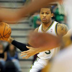 Utah's Trey Burke looks to make a pass as the Utah Jazz and the Golden State Warriors play Tuesday, Oct. 8, 2013 in preseason action at Energy Solutions arena in Salt Lake City.