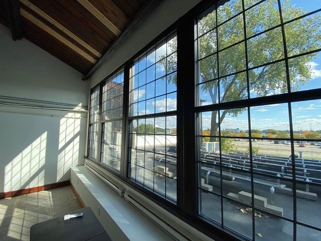 Large industrial windows that overlook the river.