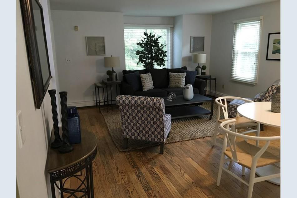 A living room-dining room area with a table and chairs.