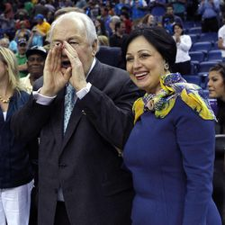 New Orleans Saints owner Tom Benson yells out after an NBA basketball game between the Hornets and the Memphis Grizzlies in New Orleans, Sunday, April 15, 2012. The Hornets won 88-75. At right is his wife, Gayle Benson. Benson has reached an agreement to buy the Hornets from the NBA.