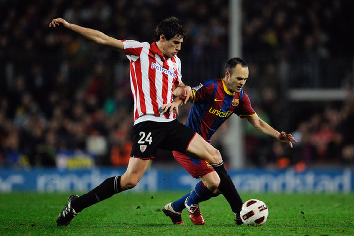 Javi Martinez -- who is the object of my desires -- duels bravely against Andres Iniesta.