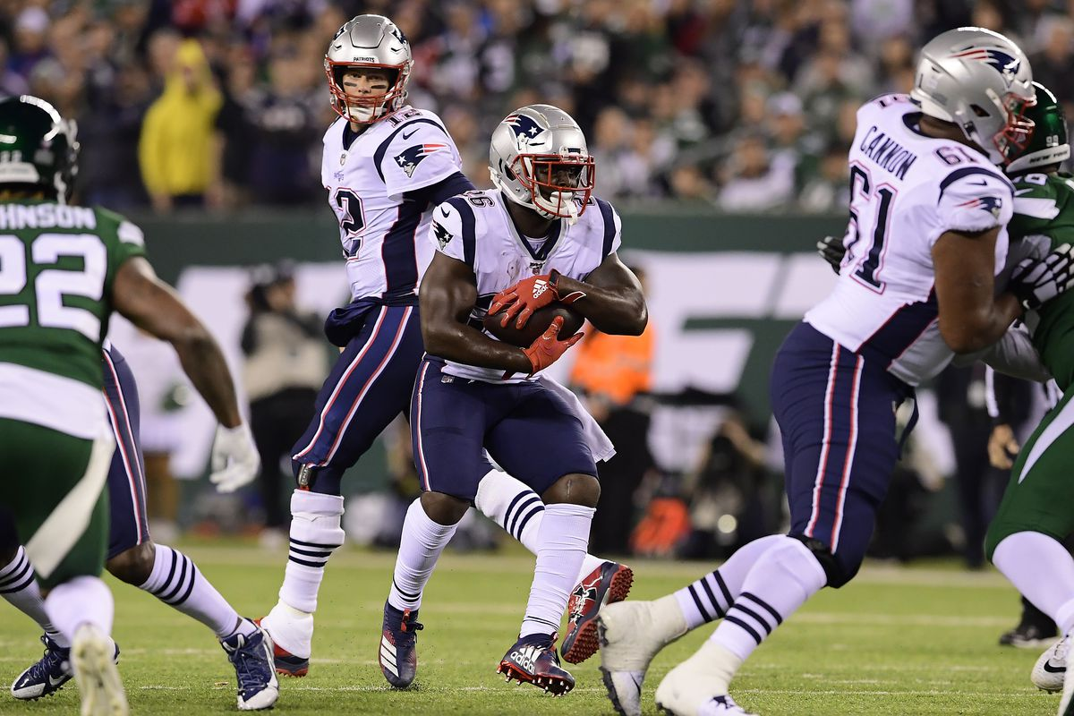 Sony Michel of the New England Patriots runs the ball against the New York Jets during the first half at MetLife Stadium on October 21, 2019 in East Rutherford, New Jersey.