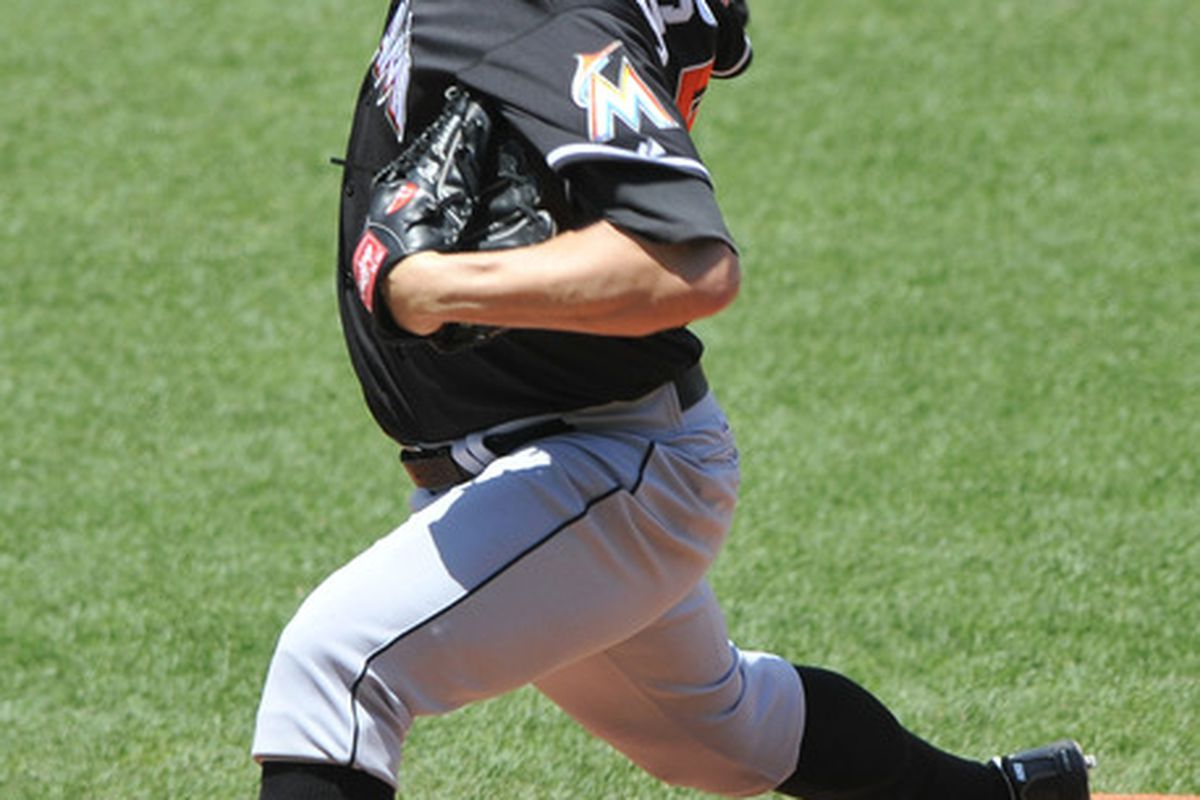 May 20, 2012; Cleveland, OH, USA; Miami Marlins starting pitcher Josh Johnson (55) delivers in the first inning against the Cleveland Indians at Progressive Field. Mandatory Credit: David Richard-US PRESSWIRE