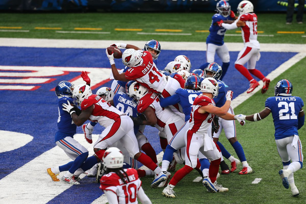 Running back Kenyan Drake #41 of the Arizona Cardinals lunges over the pile for a touchdown in the third quarter of the game against the New York Giants at MetLife Stadium on December 13, 2020 in East Rutherford, New Jersey. The Cardinals defeated the Giants 26-7.