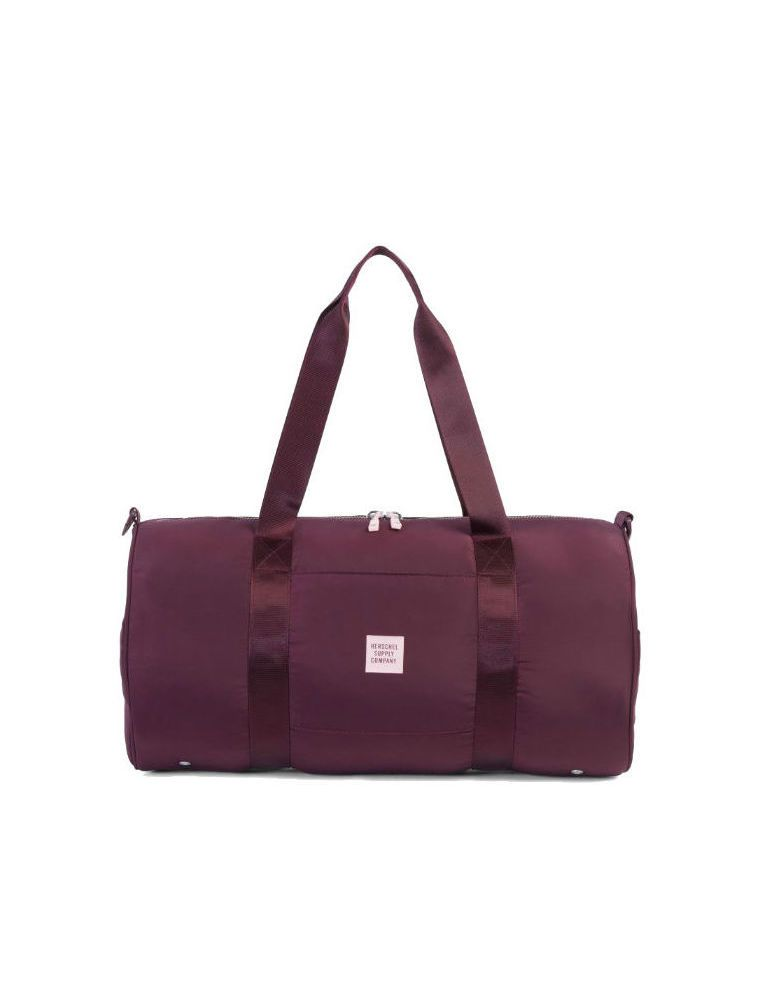A wine-colored duffle bag