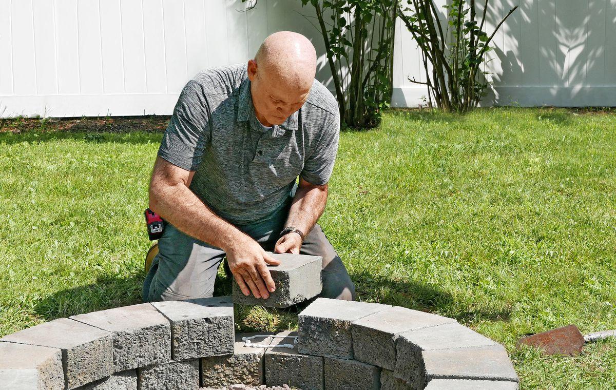 Mark McCullough builds a fire pit