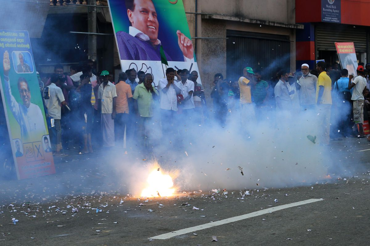 Supporters of victorious opposition candidate Maithripala Sirisena celebrate in Colombo