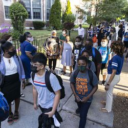 Students make their to the classrooms on the first day back to school at Mary E. Courtenay Language Arts Center at 4420 N Beacon St. in Uptown, Monday, Aug. 30, 2021.