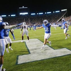 BYU players begin their celebration as they defeat Mississippi State 28-21 in Provo at LaVell Edwards Stadium on Friday, Oct. 14, 2016.