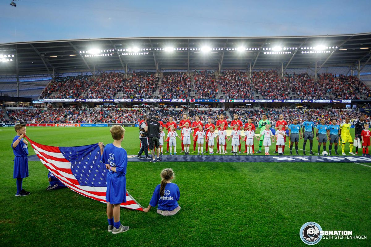 June 18, 2019 - Saint Paul, Minnesota, United States - The teams line the pitch as the national anthems are played prior to the USA vs Guyana match at Allianz Field.