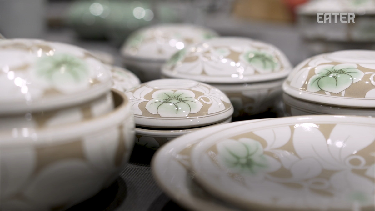 Traditional Korean handmade ceramic pots and plates with a flower design