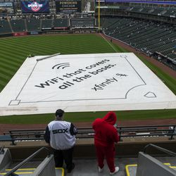 Chicago White Sox fans wait for the home opener to begin, against the Kansas City Royals, at Guaranteed Rate Field, Thursday, April 8, 2021.