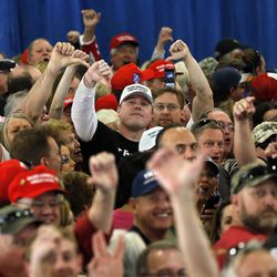 Trump supporters jeer at the media as they listen to a speech by Republican presidential candidate Donald Trump during a campaign rally, Saturday, Oct. 29, 2016, in Golden, Colo.