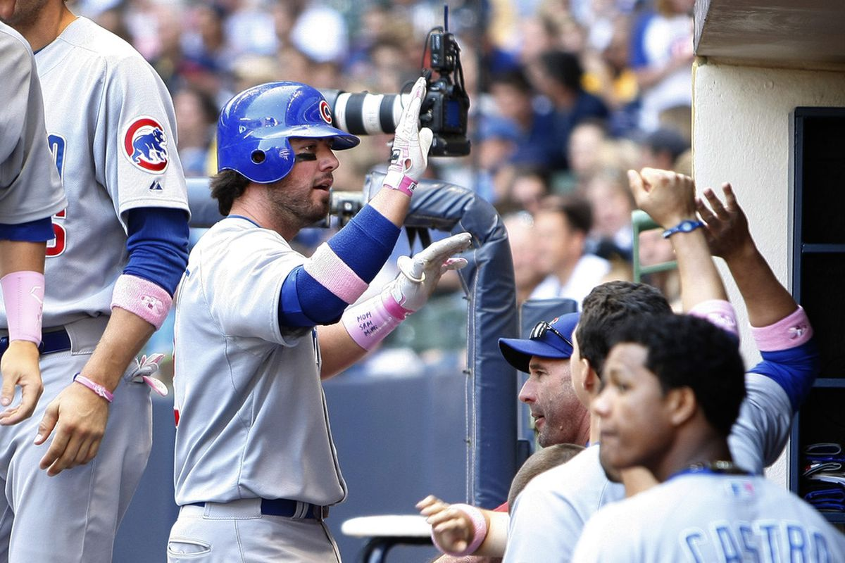 Ian Stewart of the Chicago Cubs celebrates in the dugout after hitting a solo home run against the Milwaukee Brewers at Miller Park in Milwaukee, Wisconsin. (Photo by Mike McGinnis/Getty Images)