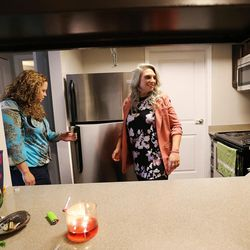 Jeannie Ybarra, left, of Salt Lake County Criminal Justice Services, look over Intensive Supervision client Crissy Elmers' apartment in Salt Lake City on Thursday, Oct. 6, 2016.
