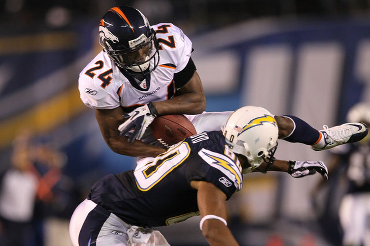 Cornerback Champ Bailey  intercepts a pass over wide receiver Malcom Floyd of the San Diego Chargers on November 22 2010.  (Photo by Stephen Dunn/Getty Images)