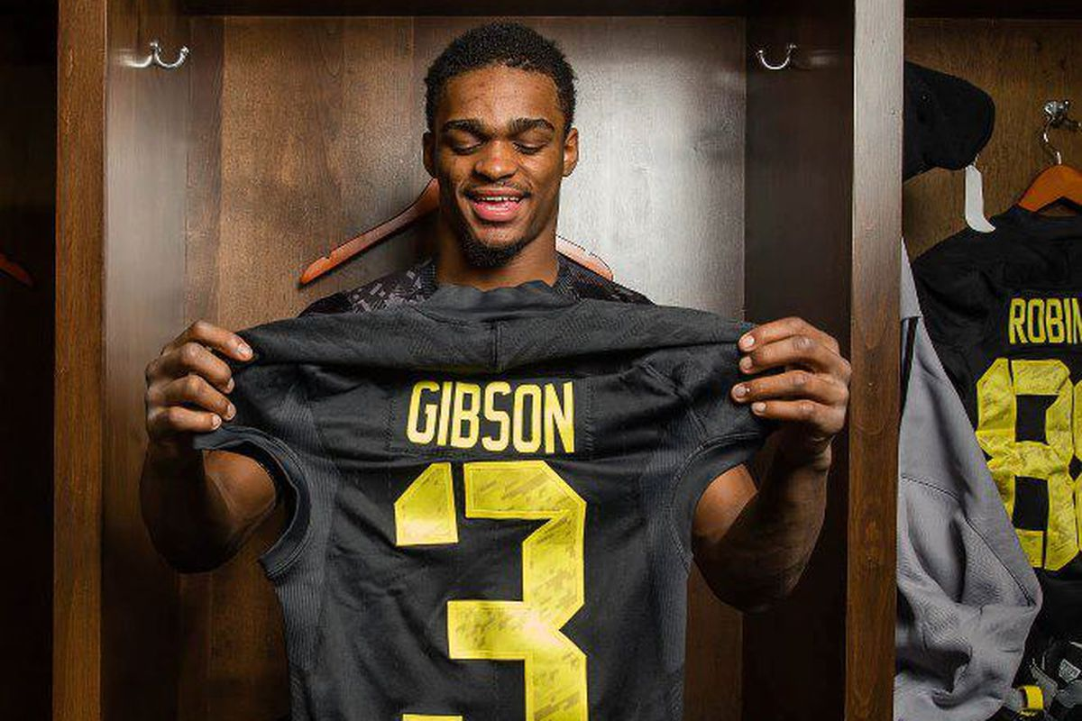 Could the next jersey Shelton Gibson holds up be a scarlet and gray one?