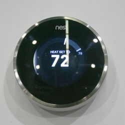"""Most thermostats are pretty ugly and hard to program, leading to energy waste. <b>Nest</b>'s simple design and self-programming <a href=""""http://nest.com/installation/""""target=""""_blank"""">thermostats</a> make saving energy look good."""