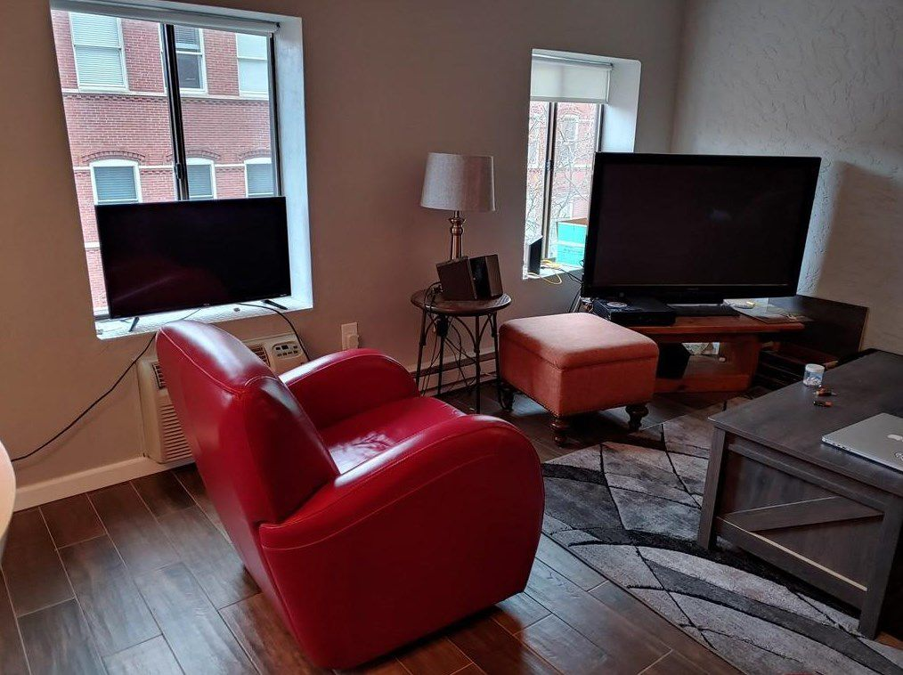 Another shot of the living room with the windows and TV prominent.