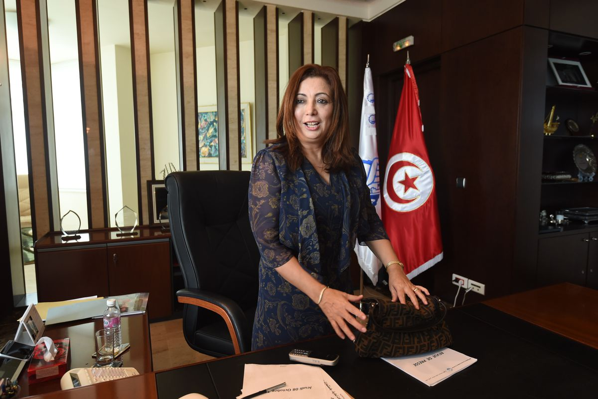 Wided Bouchamaoui, president of one of the Tunisian labor unions in the National Dialogue Quartet, talks to reporters on learning the group had won the Nobel Peace Prize.