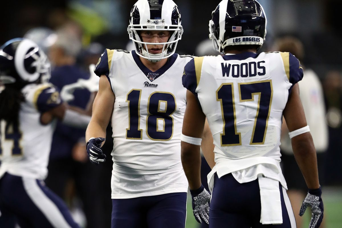 Cooper Kupp and Robert Woods of the Los Angeles Rams warm up before a game against the Dallas Cowboys at AT&T Stadium on December 15, 2019 in Arlington, Texas.