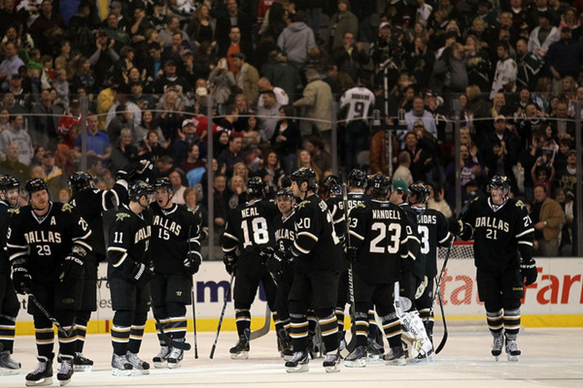 DALLAS TX - FEBRUARY 11:  The Dallas Stars celebrate the overtime win against the Chicago Blackhawks at American Airlines Center on February 11 2011 in Dallas Texas.  (Photo by Ronald Martinez/Getty Images)