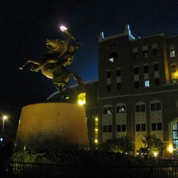 """<strong>2008- Nighttime view of """"Unconquered"""" by Fritz White at the FSU Doak Campbell football stadium</strong>"""
