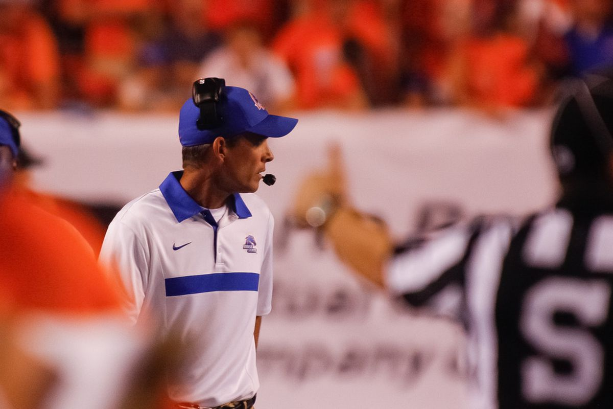 BOISE, ID - SEPTEMBER 24:  Head Coach Chris Petersen of the Boise State Broncos watches a play against the Tulsa Golden Hurricane at Bronco Stadium on September 24, 2011 in Boise, Idaho.  (Photo by Otto Kitsinger III/Getty Images)