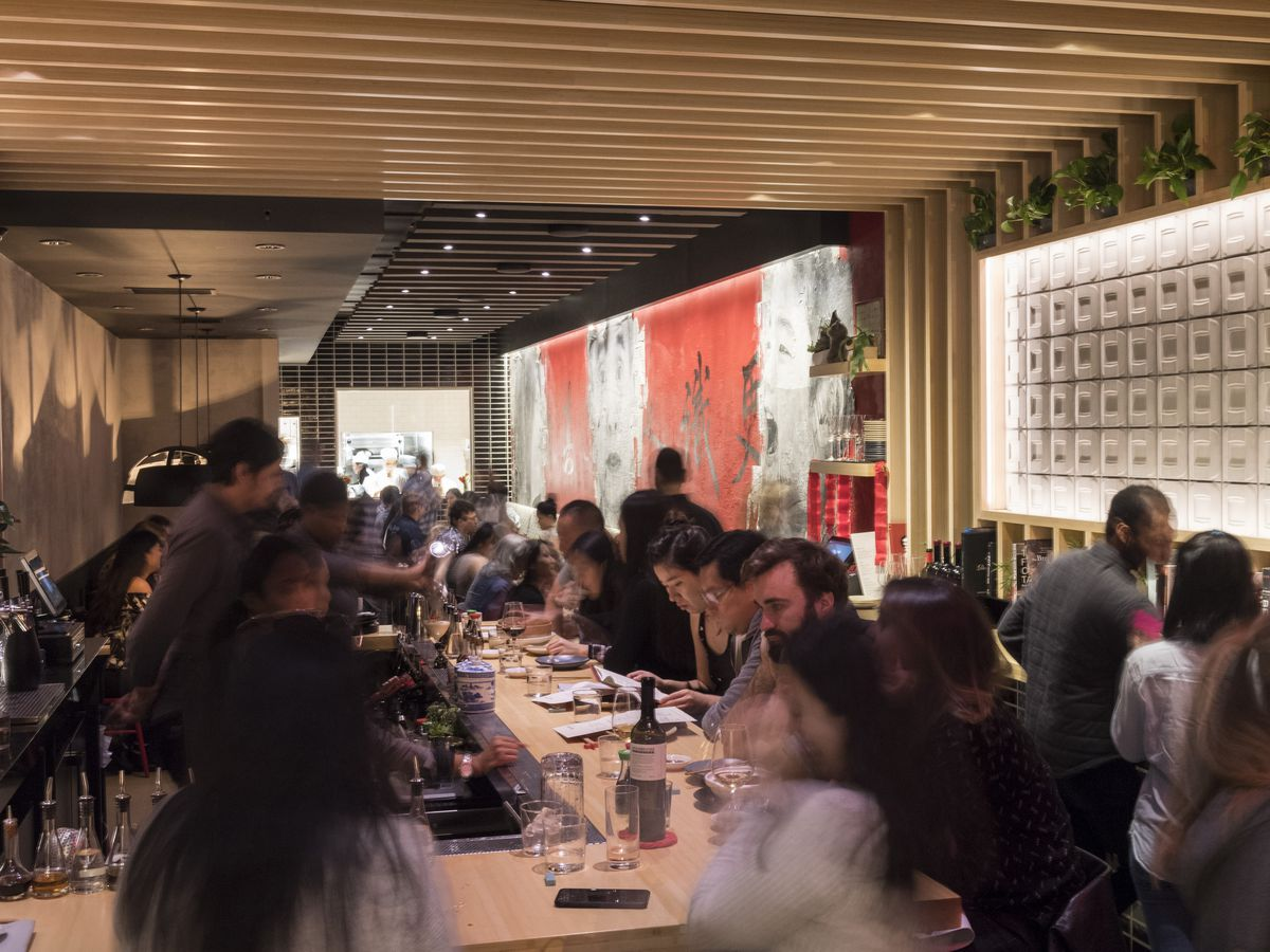 A photo of the bar at Pinch Chinese during service, lined up with customers