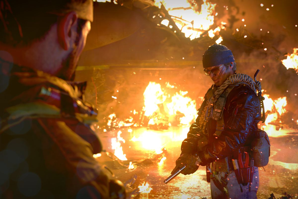 A player stands in front of burning wreckage in Call of Duty: Black Ops Cold War