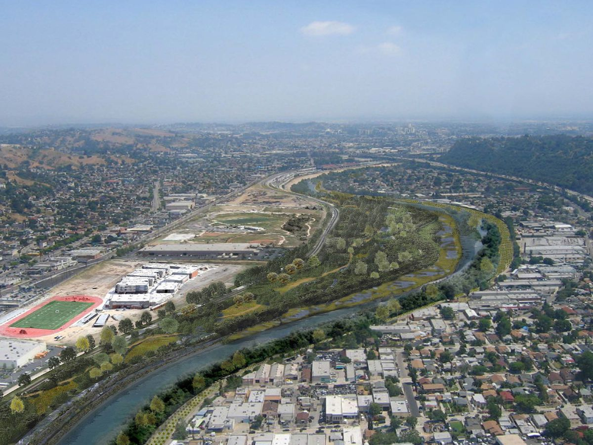 An aerial view of the Taylor Yard G2 parcel in Los Angeles, California. There is a river and on both sides of the river are many houses, buildings, schools, and parks.