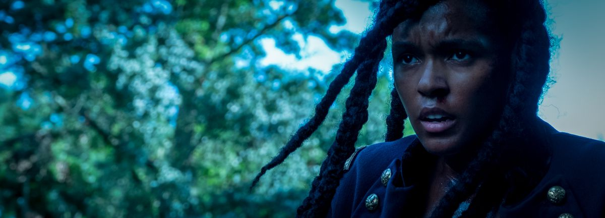 A bloodied Janelle Monáe looks wary in Antebellum