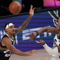 Denver Nuggets' Gary Harris (14) defends against a pass by Utah Jazz's Donovan Mitchell, right, during the first half an NBA first round playoff basketball game, Tuesday, Sept. 1, 2020, in Lake Buena Vista, Fla.