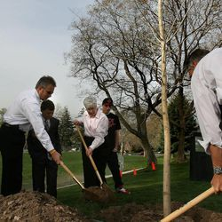 Greg Miller, his son Oakley, Gail Miller and her grandson Zane plant a  Fremont Cottonwood in honor of Larry Miller at Lindsey Gardens Park in the Avenues of Salt Lake City on April 24 , 2009.  The tree was chosen in part because of its heart-shaped leaves;   symbolic of Miller's good heart.  Laura Seitz, Deseret News