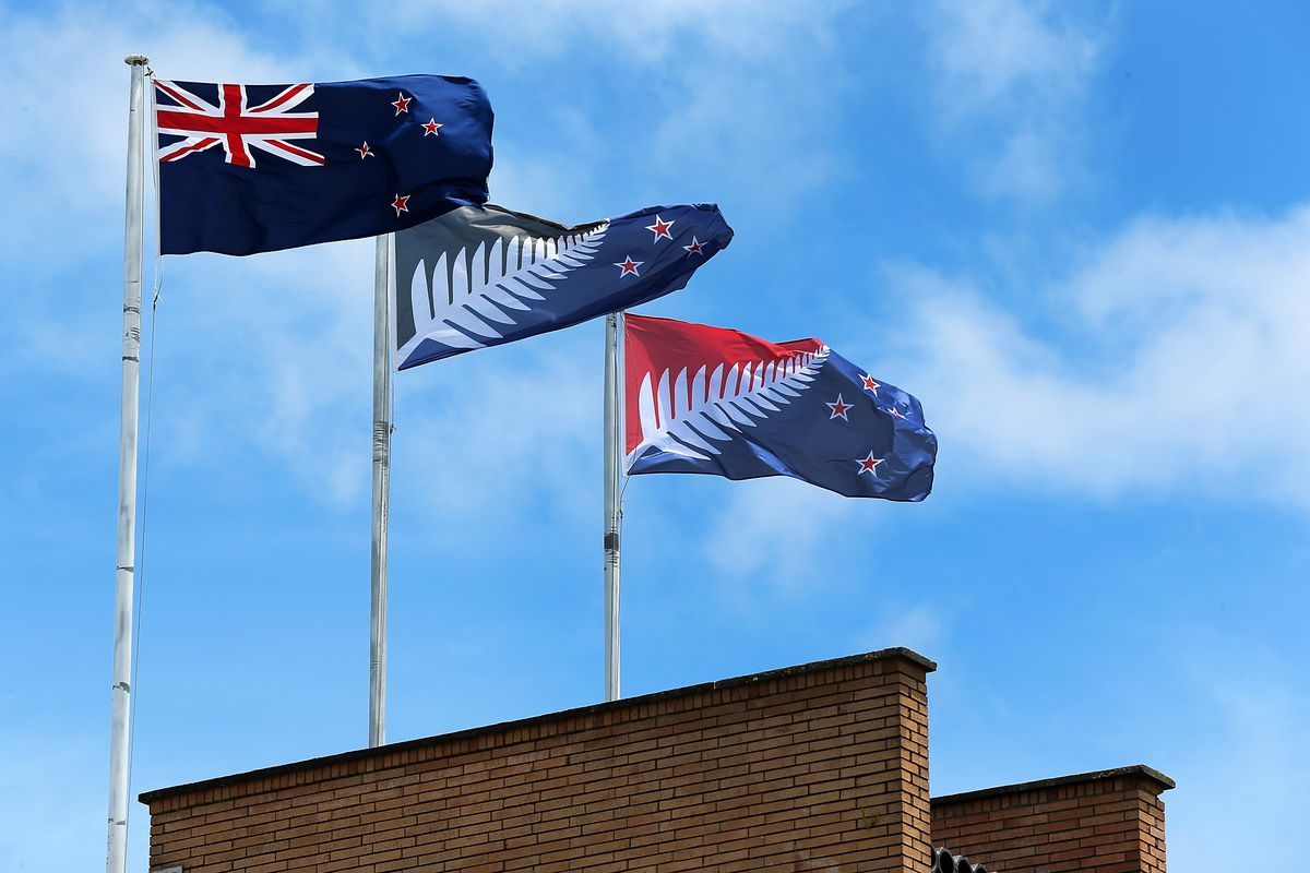 The current New Zealand flag (L), the referendum-winning blue-and-black Kyle Lockwood–designed flag (C), and the second-place red-and-blue flag (R) fly on a building in New Lynn, Auckland, on December 14, 2015, in Auckland, New Zealand.