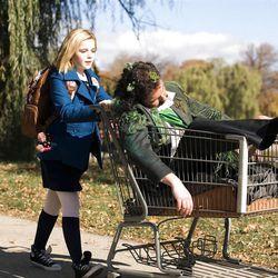"""In """"Smooch,"""" Zoe, (Kierna Shipka) rescues a man (Simon Kassianides) lying in a park."""