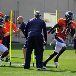 Broncos WR Emmanuel Sanders (10) and Courtland Sutton (left, 14) weave and cut through the WR course during drills.