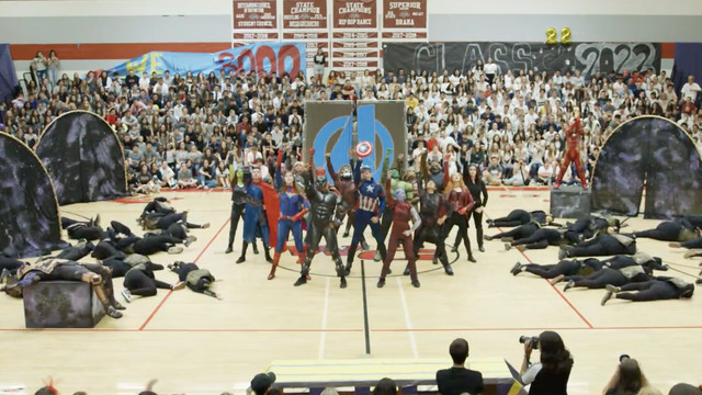 a group of high school dance team members in avengers get up