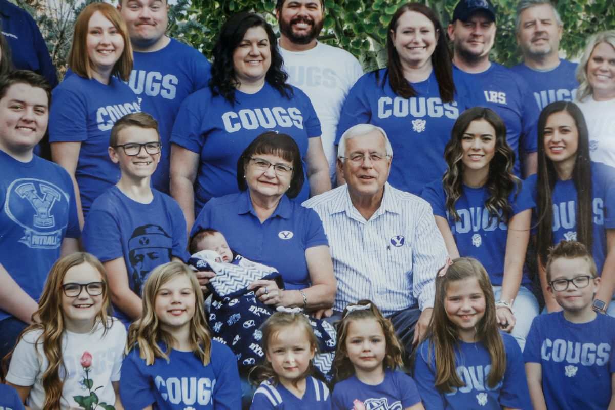 Pam Woodall, center, is photographed with her family in 2018. After Pam Woodall died of cancer before the season's start, Kelli Gard and her father, Randy Woodall, submitted photos of her to be included among the cutouts at LaVell Edwards Stadium.
