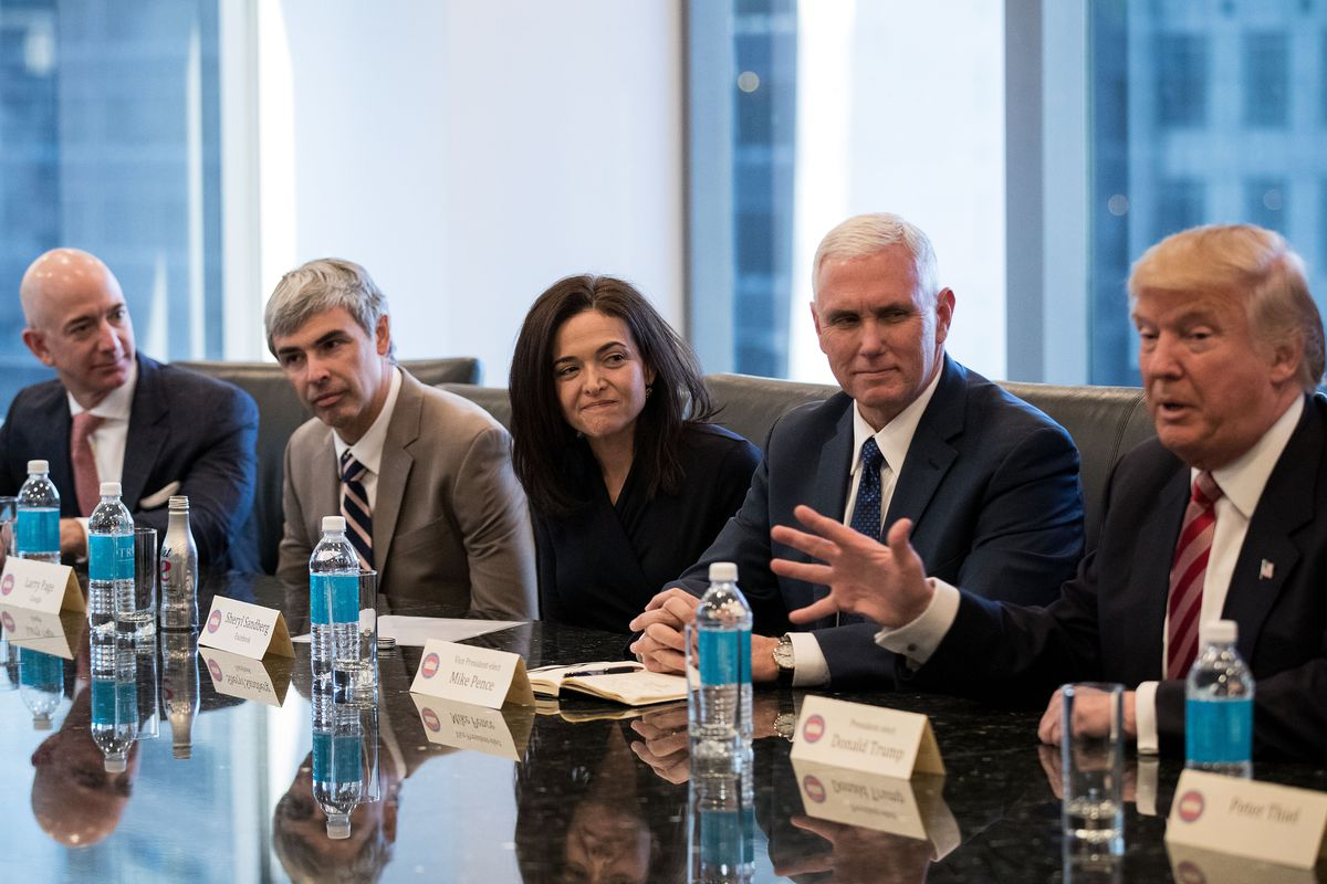Amazon CEO Jeff Bezos, Alphabet CEO Larry Page, Facebook COO Sheryl Sandberg, Vice President Mike Pence, and President Donald Trump sitting at a conference table.