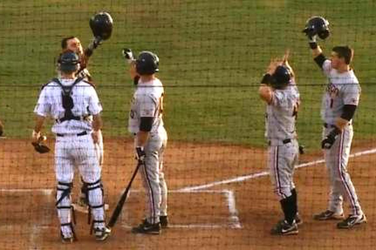 Oregon St.'s Michael Conforto celebrates his 3 run home run to start the game with his Beaver teammates as he crosses the plate.
